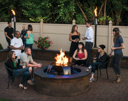 Family and Friends Gathered Around a Gas Firepit